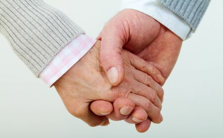 Conceptual image of mature female and male hands together Stock Photo - 11919958