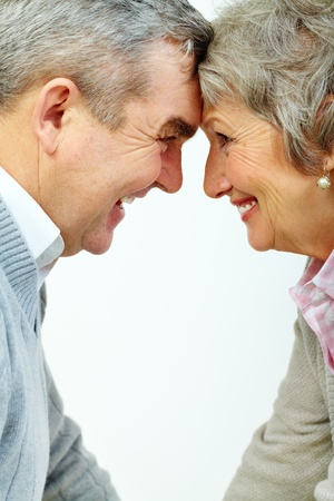 Profiles of senior woman and man face to face Stock Photo - 11920116