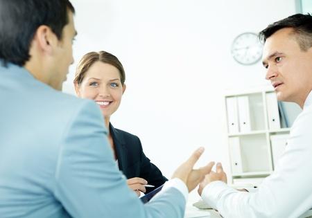 Portrait of friendly professionals planning work photo