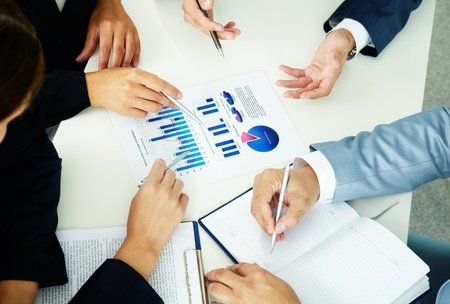 Image of human hands with pens over business documents at meeting Stock Photo - 11919942