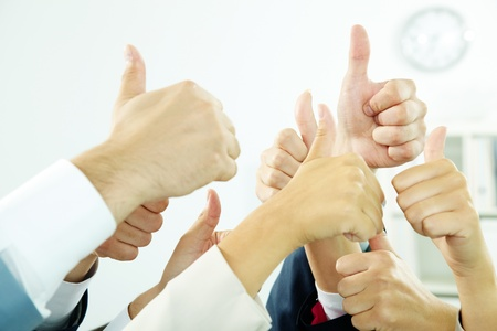 altogether: Image of several human hands showing thumbs up in isolation