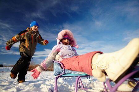 Friendly kids in winterwear having happy time outside photo