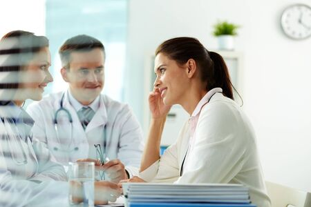 Portrait of confident practitioners consulting patient in hospital Stock Photo - 11938057