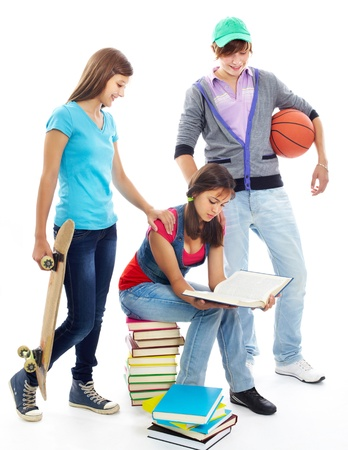highschool: Cute girl reading while her friends offering her to go out Stock Photo