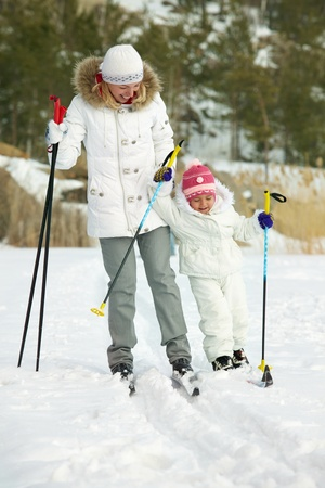 Little girl and her mother skiing in park Stock Photo - 11938248