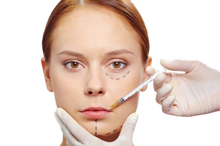 Fresh woman with marks drawn on face during botox procedure Stock Photo - 11938252