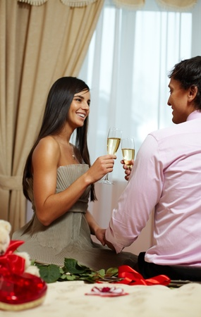 A young happy couple making toast with champagne Stock Photo - 11988640