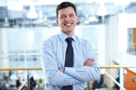Portrait of happy businessman looking at camera with smile photo