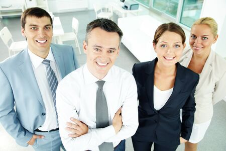 Portrait of business partners looking at camera with their leader in front Stock Photo - 11989547