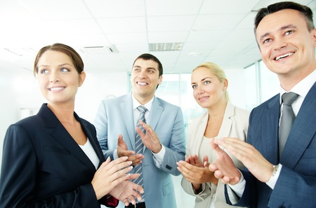 spokesman: Photo of business partners applauding while looking at spokesman