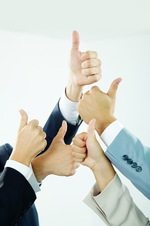 Image of several human hands showing thumbs up in isolation