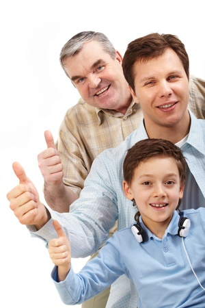 Portrait of a father, grandfather and son showing thumbs up and looking at camera photo