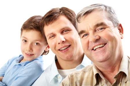 Portrait of a father, grandfather and son looking at camera photo