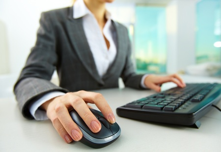 Image of female hands pushing keys of a computer mouse and keyboard Stock Photo - 11988690