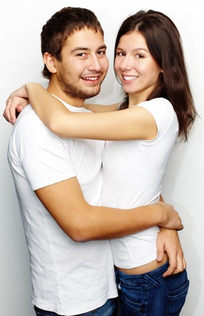 Happy woman and her husband embracing looking at camera  photo