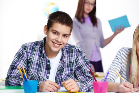 Portrait of happy lad looking at camera during lesson photo