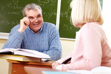 pensionary: Portrait of mature man speaking to aged female during training course