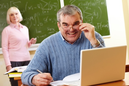 Portrait of aged male looking at camera with senior woman on background Stock Photo - 12057213