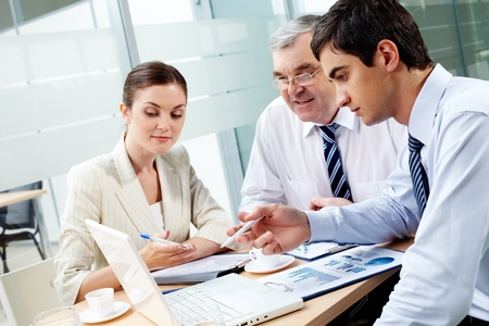 project planning: A business team of three sitting in office and planning work