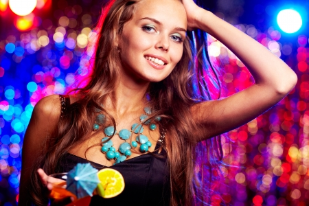 Image of happy girl with cocktail in the night club photo