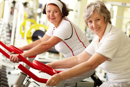 physical activity: Portrait of two senior women in gym