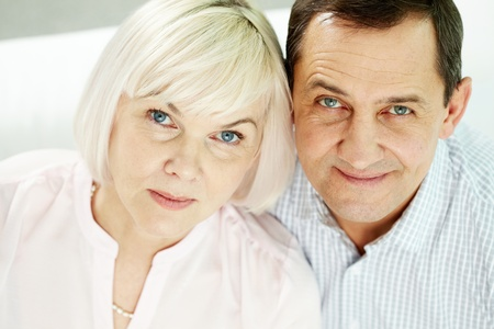 Portrait of mature woman and man looking at camera photo