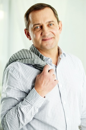 Portrait of mature man with pullover looking at camera Stock Photo