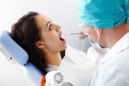 A female patient sitting in the dental chair with her mouth open Stock Photo - 12325042