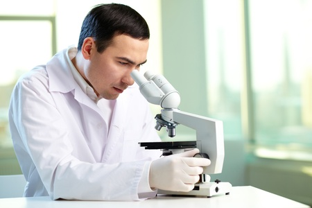 clinician: Serious clinician studying new substance in laboratory