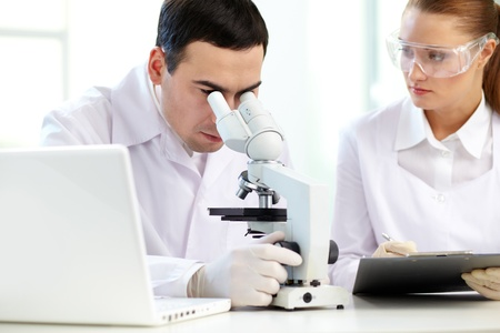 Serious clinicians analyzing chemical elements in laboratory Stock Photo - 12319589