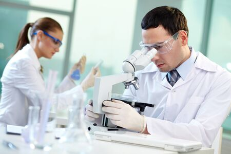 laboratories: Two scientists conducting research in a lab environment Stock Photo