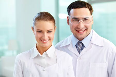 Portrait of two scientists en face looking at camera and smiling Stock Photo - 12319524