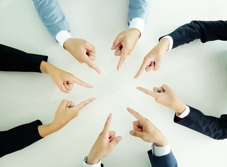 Top view of businesspeople pointing at each other photo