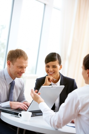 Business team working together with laptop Stock Photo - 12319581