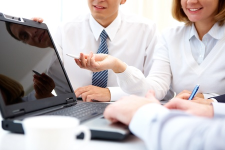 Business woman presenting the project to her colleagues Stock Photo - 12319544