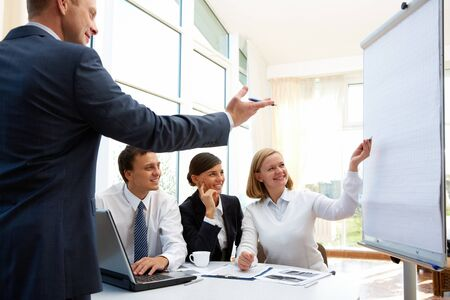 businessteam: Happy businessman pointing out the aspects of the project