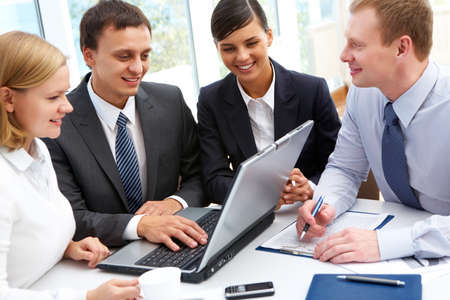 Group of businesspeople gathered to have a discussion about business plan Stock Photo - 12326471
