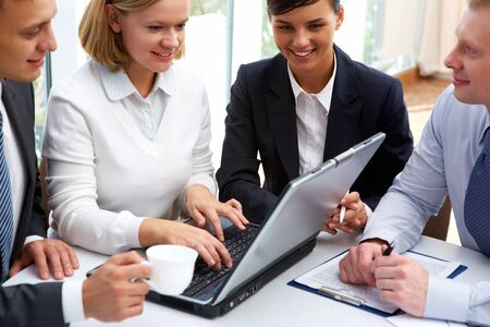Smiling businesswoman showing her strategy to the partners photo