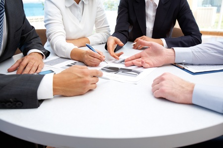 corporate training: Image of business people hands working with papers at meeting