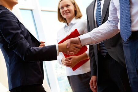 consensus: Image of business partners handshake after signing new contract Stock Photo