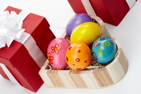 Tilt up of an Easter still-life with painted eggs and giftboxes photo