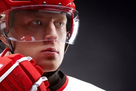 Portrait of a hockey player against black backround photo