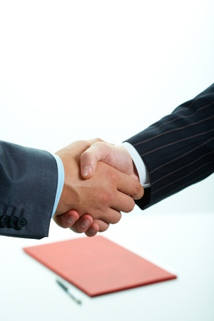 joined hands: Close-up of two shaking hands
