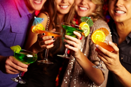 friends at bar: Young people having fun at a party with cocktails Stock Photo