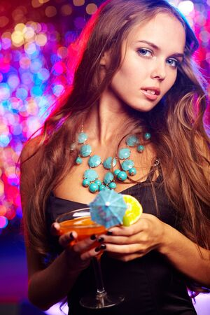 party outfit: Girl in a stylish outfit spending time at a party Stock Photo