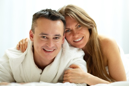 woman middle age: Happy couple looking at camera with smiles