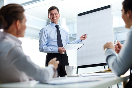 success business: Cheerful businessman discussing a new business project with the members of his team
