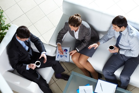 Overview of business team discussing some graphs and diagrams Stock Photo - 12328411
