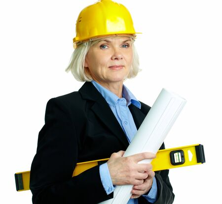 female architect: Portrait of smiling businesswoman in helmet holding rolled blueprints and instrument