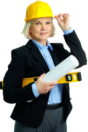 Portrait of smiling businesswoman in helmet holding rolled blueprints and instrument photo